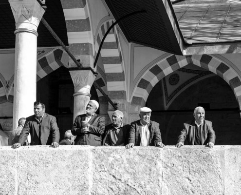 A group of Turkish men are enjoying their time after their pray.